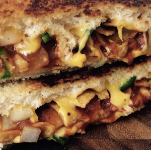 Ms. Cheezious: House smoked honey mustard BBQ turkey, pepper jack cheese and jalapeño slaw on sourdough